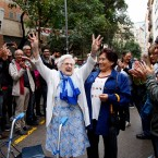 In this Sunday, Oct. 1, 2017 photo, an elderly lady is applauded as she celebrates after voting at a school assigned to be a polling station by the Catalan government at the Gracia neighborhood in Barcelona, Spain. (AP Photo/Bob Edme, File)