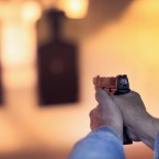 A marksman sights in on a target during a class for an Illinois concealed carry permit in February 2014.