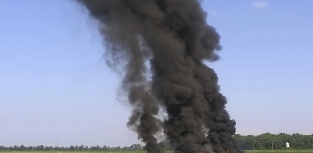 Smoke and flames rise where a military transport plane crashed near Itta Bena, Miss., on Monday, killing at least 16.
