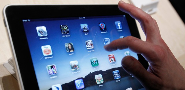 In this Jan. 27, 2010 file photo, the iPad is shown after it was unveiled at the Moscone Center in San Francisco. Apple Inc. said Thursday, Sept. 9, 2010, that it will publish the guidelines it uses to determine which programs can be sold in its App Store.