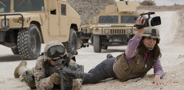 Evan Jonigkeit plays Specialist Coughlin and Tina Fey plays Kim Baker in Whiskey Tango Foxtrot.