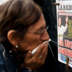 "A woman reads front pages of newspapers at a news stand in Lima, Peru, Tuesday, June 7, 2016. The front page of La Razon newspaper reads in Spanish: ""The fight continues!"" The nail-biter race for Peru's presidency tightened Tuesday as the daughter of imprisoned ex-president Alberto Fujimori gained ground on her rival thanks to votes trickling in from remote rural areas and embassies abroad. Former World Bank economist Pedro Pablo Kuczysnki has a razor-thin lead over Keiko Fujimori."