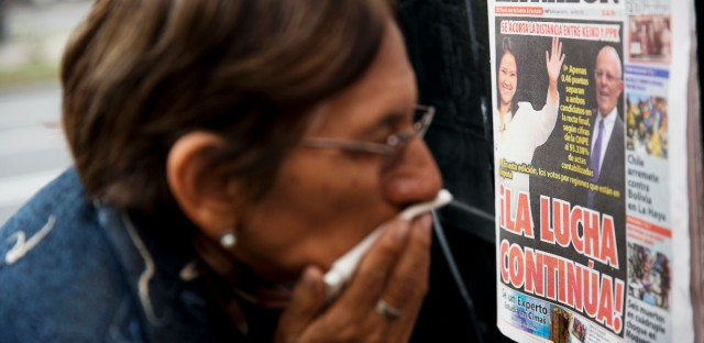 "A woman reads the front page of La Razon newspaper, which reads ""The fight continues!"" The nail-biter race for Peru's presidency tightened Tuesday as the daughter of imprisoned ex-president Alberto Fujimori gained ground on her rival thanks to votes trickling in from remote rural areas and embassies abroad. Former World Bank economist Pedro Pablo Kuczysnki has a razor-thin lead over Keiko Fujimori."
