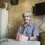 Stanislav Petrov, a former Soviet military officer, poses at his home in 2015 near Moscow. In 1983, he was on duty when the Soviet Union's early-warning satellite indicated the U.S. had fired nuclear weapons at his country. He suspected, correctly, it was a false alarm and did not immediately send the report up the chain of command. Petrov died at age 77. (Pavel Golovkin/AP)