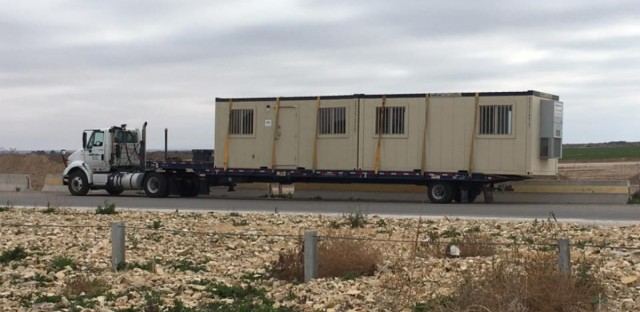 A mobile office unit being removed from the Tornillo Detention Facility. The facility has been under scrutiny as the largest of several where migrant children are being detained.
