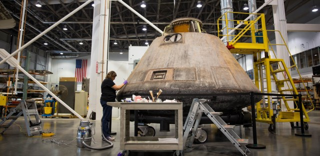 The Apollo 11 capsule in in sore need of restoration, conservation specialists say, if it's to last another 50 years. Even the adhesive that helps holds stuff in place is losing its stickiness, and some objects inside are starting to pop off.