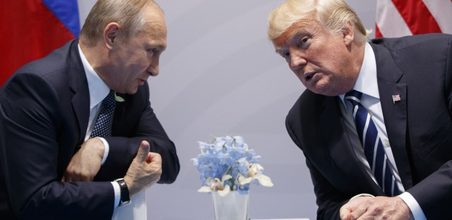 President Trump meets with Russian President Vladimir Putin at the Group of 20 summit in early July. It's unclear how the sanctions Trump signed into law Wednesday will affect the personal relationship between the two men.
