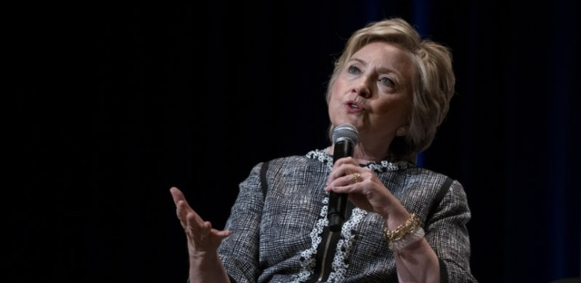 Hillary Clinton speaks in New York in June. President Trump and his supporters claim that in exchange for millions of dollars in donations to The Clinton Foundation, Clinton supported the 2010 sale of a mining company that gave Russia control of U.S. uranium supplies. The story has again resurfaced, though fact checks do not support the claims.