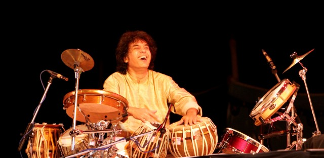 Indian tabla maestro Zakir Hussain perform during a musical concert 'Remember Shakti' in Bangalore, India, Wednesday, Dec. 13, 2006.
