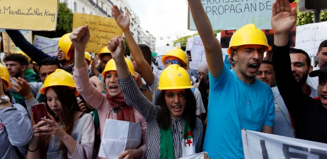"Students carry banners and chant slogans during a demonstration in Algiers, Algeria, Tuesday, April 16, 2019. President of the Algerian Constitutional Council Tayeb Belaiz resigned on Tuesday amid mass protests in the country demanding for his departure. ""Belaiz notified the members of the Constitutional Council, during a meeting held Tuesday, that he presented his resignation to the interim president Abdelkader Bensalah,"" the council said in a statement."