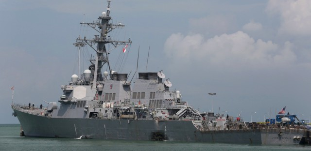 The guided-missile destroyer USS John S. McCain moored pier side at Changi naval base in Singapore.