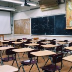 empty classroom with chalkboards hanging on the wall