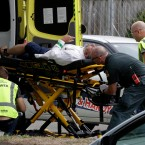 "Ambulance staff take a man from outside a mosque in central Christchurch, New Zealand, Friday, March 15, 2019. Multiple people were killed in mass shootings at two mosques full of worshippers attending Friday prayers on what the prime minister called ""one of New Zealand's darkest days,"" as authorities detained four people and defused explosive devices in what appeared to be a carefully planned attack."