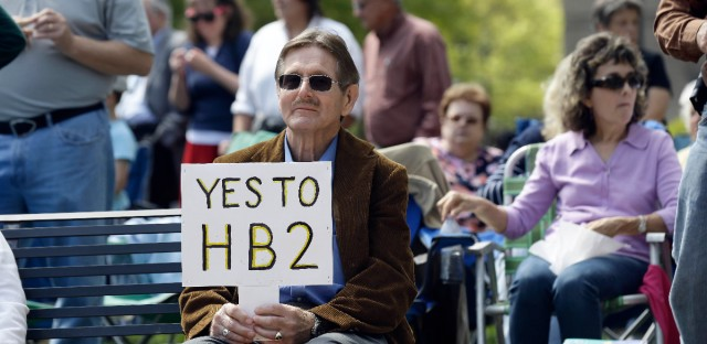 Supporters of House Bill 2 gather at the North Carolina State Capitol in Raleigh, N.C., Monday, April 11, 2016, during a rally in support of a law that blocks rules allowing transgender people to use the bathroom aligned with their gender identity.