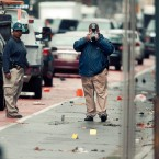 Evidence teams investigate at the scene of Saturday's explosion on West 23 Street in Manhattan's Chelsea neighborhood, Monday, Sept. 19, 2016, in New York. An Afghan immigrant wanted for questioning in the bombings that rocked a New York City neighborhood and a New Jersey shore town was captured Monday after being wounded in a gun battle with police.