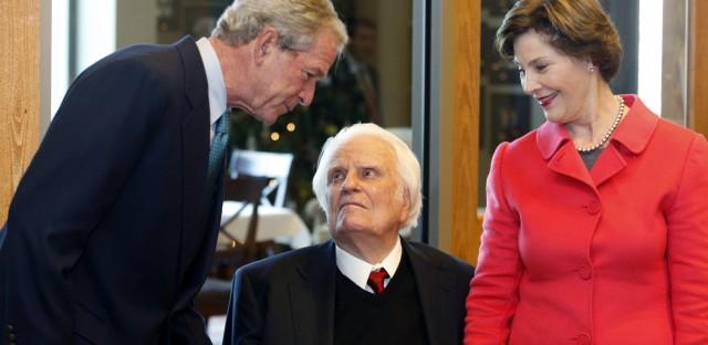 Former President George W. Bush and Laura Bush greet evangelist Billy Graham in 2010.