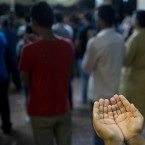 Sunni Muslims living in Greece pray on the first day of Eid al-Fitr prayers in Piraeus near Athens, Wednesday, July. 6, 2016. Muslims worldwide are celebrating Eid al-Fitr, marking the end of the Muslim holy fasting month of Ramadan.