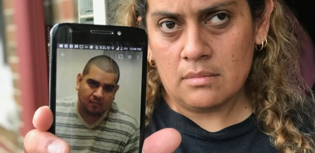 Maribel Ornelas holds an image of her brother Nicolas Garcia, 36, who was killed on his motorcycle July 4 in a hit-and-run crash on Chicago's Northwest Side. She says the family wants to hear more often from police about the investigation.