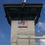 A Humvee passes the guard tower at the entrance of the U.S. prison at Guantanamo Bay in October 2016.