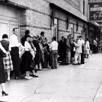 "Theater-goers wait on line to buy tickets for the Broadway musical ""My Fair Lady"" at the Mark Hellinger Theatre in New York City, July 30, 1956."