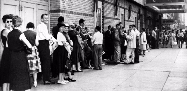 """Theater-goers wait on line to buy tickets for the Broadway musical """"My Fair Lady"""" at the Mark Hellinger Theatre in New York City, July 30, 1956."""