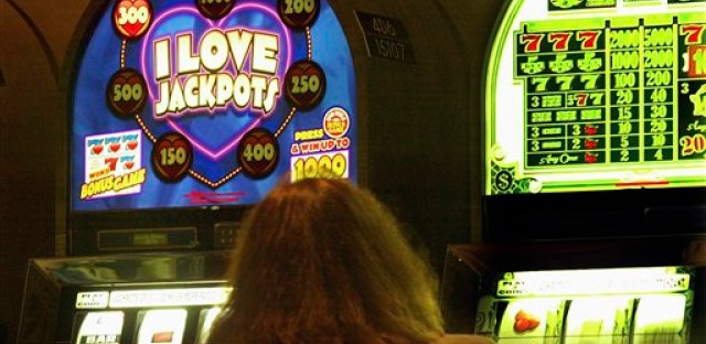 In this photo taken in May 2003, a patron plays a slot machine at the Empress Casino in Joliet, Ill.