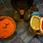 A Nepalese spice vendor waits for customers at Ason market in Katmandu, Nepal, Tuesday, Feb. 5, 2013. Ason is one of the busiest and oldest market in Katmandu. (AP Photo/Niranjan Shrestha)