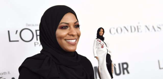 """Olympic fencer Ibtihaj Muhammad holds a hijab-wearing """"Barbie Shero"""" in her likeness at the 2017 Glamour Women of the Year Awards on Monday."""