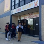 Students stand outside a Noble Academy charter school location. After months of disagreements between the school district and charter school officials over how charter schools should be funded, CPS released its charter schools budgets Friday.