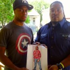 Toussaint Reed and Malcolm Rashad hold a picture of their slain friend Cornelius Jordan. They say the West Englewood native was mislabeled as a gang member at the time of his shooting death.
