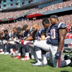 Members of the New England Patriots — and players across the league — kneel during the national anthem before Sunday's game against the Houston Texans. Jim Rogash/Getty Images