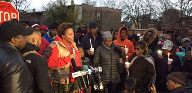 Karonisha Ramsey (center), the mother of 19-year-old Kajuan Raye, speaks at a vigil after a Chicago police sergeant fatally shot her son the night before Thanksgiving.