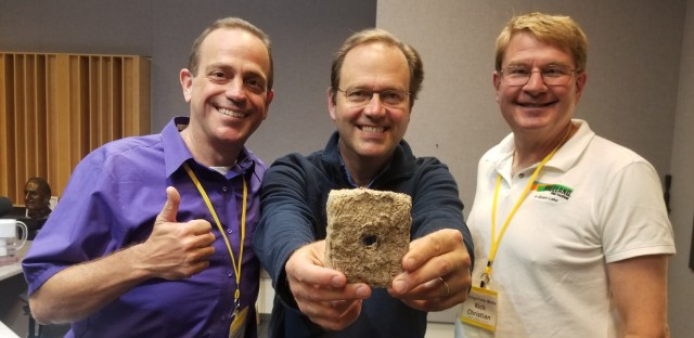 Jerome with Fuego del Sol's Kevin Adair and Rich Christian of the Freeland Film Festival. Jerome is holding one of Fuego del Sol's sustainable briquettes.