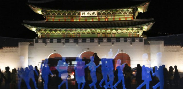 Holograms of human figures are displayed during a 'ghost protest' against South Korea's president in front of the Gyeongbok Palace in Seoul on Wednesday. Amnesty International in Korea said it decided to use the holograms after protesters were denied permission to march. See the video below.