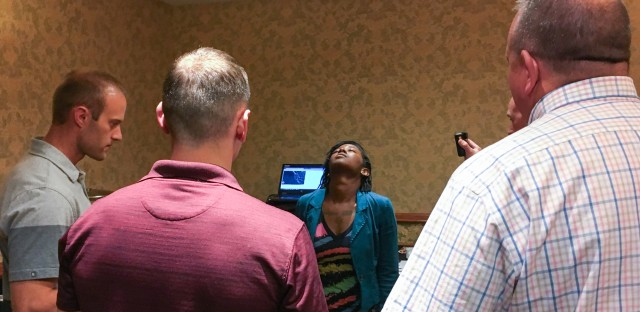 Volunteer Sharica Clark counts 30 seconds with her eyes closed, as officers with Colorado State Patrol check her balance and counting skills after using cannabis. It was part of a simulated roadside sobriety test in the officers' training seminar.