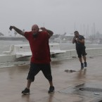 Raul Barral (left) and Carlos Guerra walk through high wind and driving rain in Corpus Christi, Texas, Tuesday as Hurricane Harvey approaches the Gulf Coast.