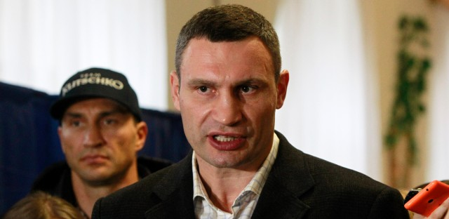Kiev's current mayor and former heavyweight boxing champion Vitali Klitschko, center, speaks with media after casting his vote at a polling station during local elections in Ukraine, Sunday, Nov. 15, 2015. The second round of elections will be held in 29 cities of Ukraine.