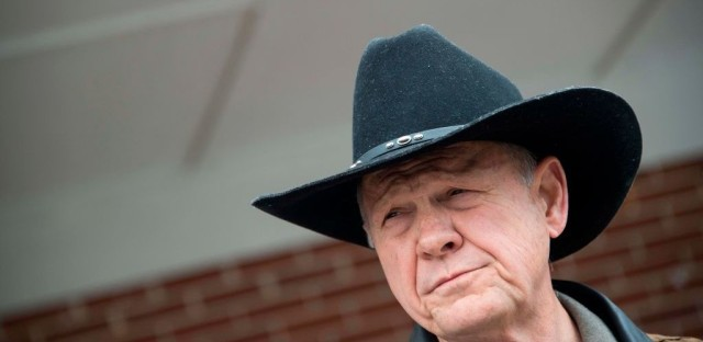 Alabama GOP Senate nominee Roy Moore speaks to the media after arriving at a polling station in Gallant, Ala., on Tuesday.