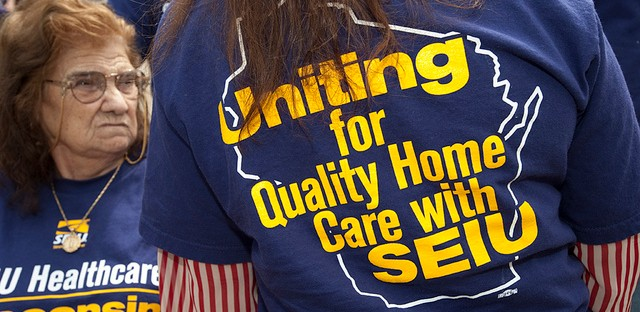 A woman displays her SEIU home care worker shirt. Organizers celebrating the thirty year anniversary of a home care worker movement.