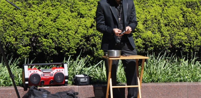 Magician and dancer Ozzie Leyva. He says he makes $80-$100 on a good day doing magic in downtown Chicago.