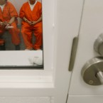 In this photo taken on Friday, Oct. 17, 2008 detainees are shown inside a holding cell at the Northwest Detention Center in Tacoma, Wash. The facility is operated by The GEO Group Inc. under contract from U.S. Immigrations and Customs Enforcement, and houses people whose immigration status is in question or who are waiting for deportation or deportation hearings.