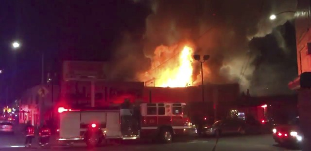 This photo taken from video provided by @OaklandFireLive shows the scene of a fire in Oakland, early Saturday, Dec. 3, 2016.