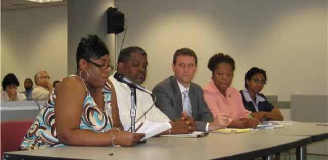 AFSCME representatives testify to state legislators about teh proposed merger of DJJ and DCFS. (WBEZ/Gabriel Spitzer)