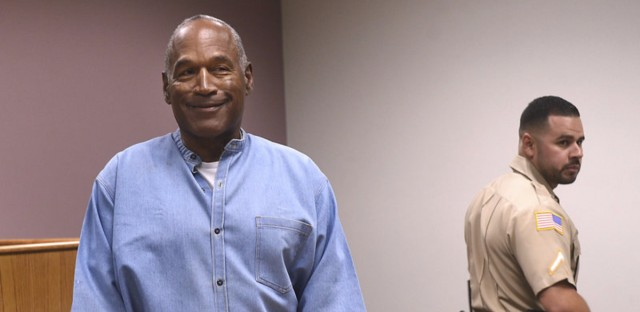 Former NFL football star O.J. Simpson enters for his parole hearing Thursday at the Lovelock Correctional Center in Lovelock, Nev. The panel decided Simpson could be released as early as October after serving 9 years in prison. (Jason Bean/The Reno Gazette-Journal/AP)