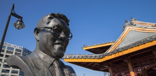 A statue of businessman and civic leader Ping Tom in the Chinatown park that bears his name. .