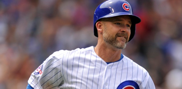 Chicago Cubs' David Ross watches his three-run home run during the fourth inning of a baseball game against the Philadelphia Phillies, Friday, May 27, 2016, in Chicago.