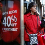 Shoppers walk out of the Express apparel store on Chicago's Magnificent Mile on Nov. 26, 2010.