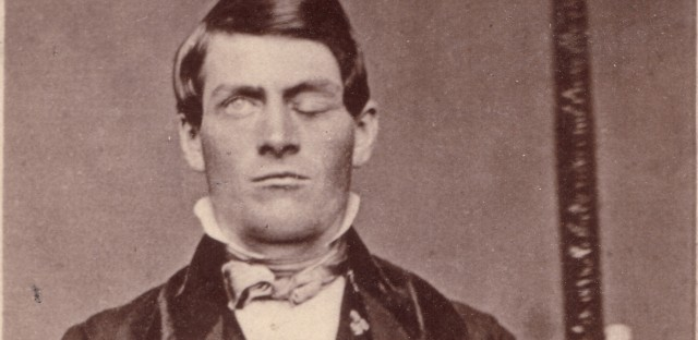 Cabinet-card portrait of brain-injury survivor Phineas Gage (1823–1860), shown holding the tamping iron that injured him.