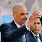 "Former U.S. Attorney General Eric Holder, left, speaks at a news conference to discuss the proposed California ""sanctuary state bill"" as California state Senate President pro Tempore Kevin de Leon listens on June 19, 2017."