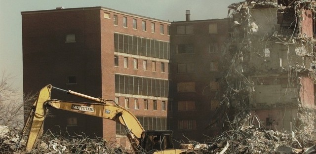 A bulldozer piles up metal debris as demolition continues on high rises at the Henry Horner Homes housing project in Chicago Feb. 9. 1996.